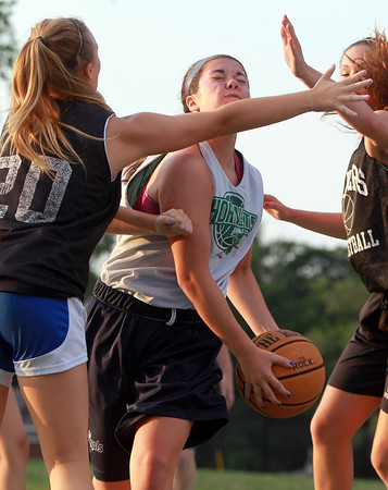 Danvers: Manchester-Essex Sydney Christopher tries to split two Danvers defenders while being fouled. David Le/Gloucester Daily Times