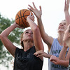 Danvers: Danvers' Ashley Arnoldy goes up strong to the hoop around the block attempt from Manchester-Essex's Emily Adams on Tuesday evening. David Le/Salem News