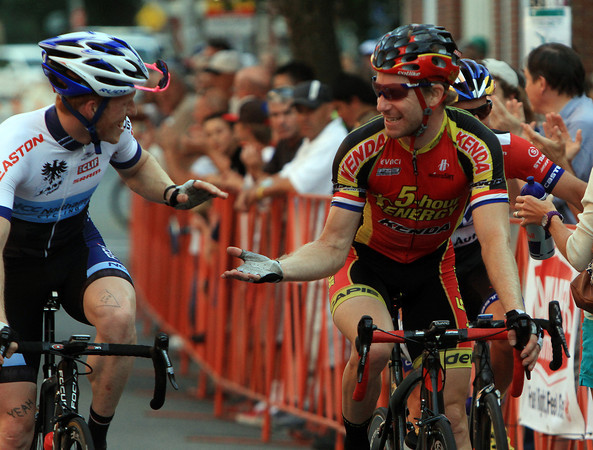 Beverly: Beverly native and winner of the Elite Men's race in the Beverly Gran Prix, Shawn Milne, right, shakes hands with Stephen Hyde, who Milne barely edged out at the finish line to take home first place. David Le/Salem News