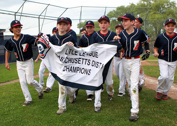 Nahant: The Peabody West Williamsport 12-year-old all-stars carry the District 16 championship banner around the Nahant Little League Field on Thursday evening following a 6-3 win over Lynnfield. David Le/Salem News