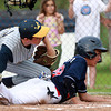 Nahant: Peabody West leadoff hitter Josh Cerratani slides home safely around Lynnfield starting pitcher Matt Relihan, left, scoring the first run of the game on a wild pitch. David Le/Salem News