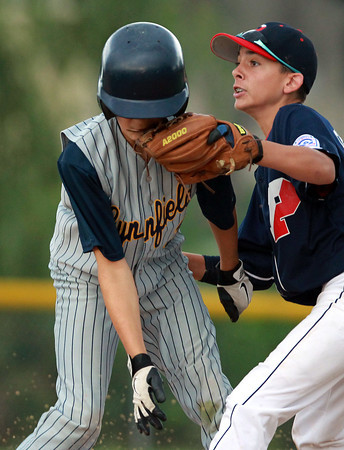 Nahant: Peabody West second baseman Josh Cerratani, right, applies a quick tag to a Lynnfield runner on a close play at second base. David Le/Salem News