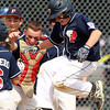 West Roxbury: Peabody West first baseman Dan Marshall (15) leaps in the air and lands on home plate as his teammates crowd around to celebrate Marshall's grand slam which broke an 8-8 tie with Holden in the top of the 4th inning. Peabody West went onto defeat Holden by a score of 20-10 in 5 innings of play. David Le/Salem News
