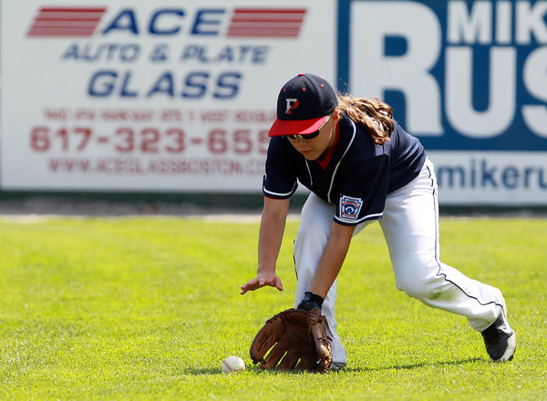 West Roxbury: Peabody West right fielder Caroline Kukas (5) fields a slow grounder to the outfield. David Le/Salem News