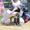 West Roxbury: Peabody West relief pitcher Josh Cerratani (8) slides into home plate as he tried to score on a sacrifice fly, but was tagged out by Holden catcher Johnny Flynn. David Le/Salem News