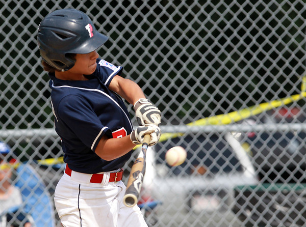 West Roxbury: Peabody West shortstop Nick Iannuzzi (7) connects on a solo home run in the top of the 4th inning of play, extending Peabody West's lead over Holden to 15-8. David Le/Salem News