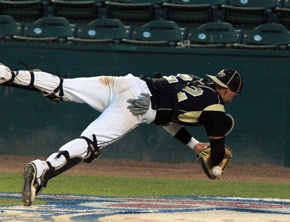 Lynn: Bishop Fenwick senior catcher Gianni Esposito makes a diving effort but can't manage to hang onto a short popup behind the plate. David Le/Salem News