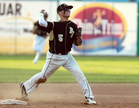 Lynn: Bishop Fenwick junior third baseman Nick Bona fires a strike to first base after making a sliding stop deep down the third base line. David Le/Salem News