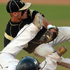 Lynn: Bishop Fenwick third baseman Nick Bona avoids a sliding St. Mary's baserunner and applies the tag on a close play at third. David Le/Salem News