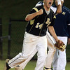 Lynn: Bishop Fenwick first baseman Brian Burke pumps his fist after doubling off a St. Mary's baserunner off first base on a strike from left fielder Jhon Oliviera. David Le/Salem News