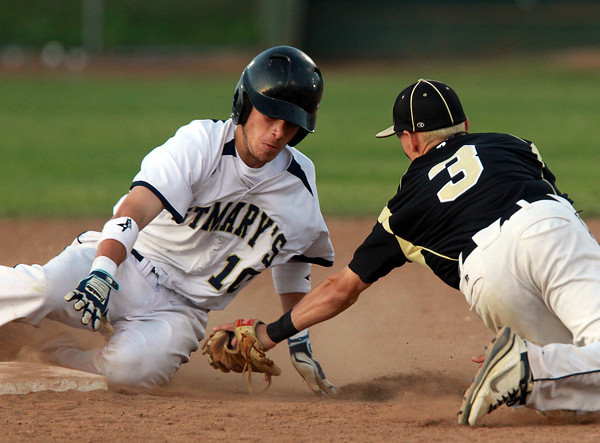 Lynn: Bishop Fenwick shortstop Mike MacKenzie dives to apply the tag to sliding St. Mary's runner Bryan Nerich, but is too late as the Spartan left fielder beats the throw for a successful steal attempt. David Le/Salem News