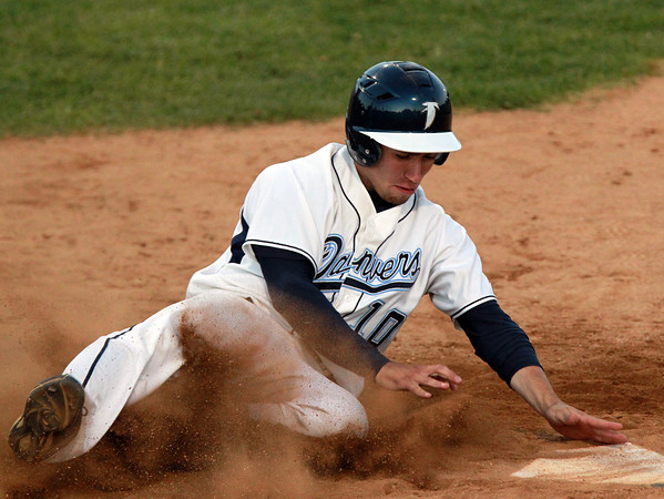 Danvers: Danvers senior Joe Strangie slides safely into home plate to score the Falcons' second run of the evening. David Le/Salem News