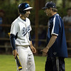 Danvers: Danvers senior Joe Strangie talks with Danvers Head Coach Roger Day during the 9th inning of the Falcons 7-6 come from behind win over Reading. David Le/Salem News