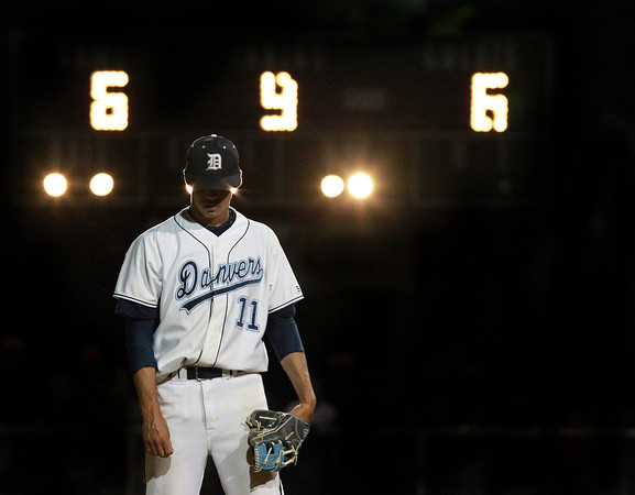 Danvers: Danvers junior Rafael Tylus takes a moment to compose himself on the mound before throwing another pitch during the 9th inning of a 6-6 ballgame. David Le/Salem News