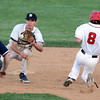 Danvers: Danvers senior Dan Connors receives a strike from catcher Joe Olszak and tags out a stealing Reading base runner. David Le/Salem News