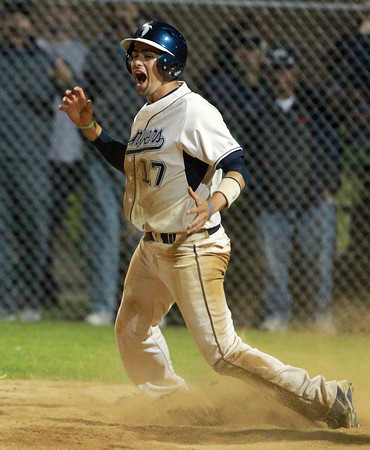 Danvers: Danvers senior AJ Couto leaps up in excitement after he scored the walk-off, game winning run, on a successful suicide squeeze laid down by Dan Connors, to give the Falcons a dramatic 7-6 win. David Le/Salem News