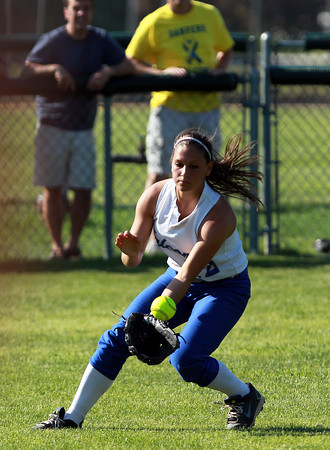 Danvers: Danvers senior center fielder Julia Saggese fields a one hop liner and looks to throw out an advancing Tewksbury runner on Saturday afternoon. David Le/Salem News
