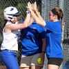 Danvers: Danvers sophomore Caitlin McBride gets a high five from assistant coach Caite Ward after McBride doubled home two runs against Tewksbury on Saturday evening. David Le/Salem News