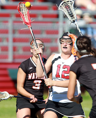 Marblehead: Marblehead senior midfielder Meggie Collins fires a shot on net against Wayland on Tuesday afternoon. Collins and the Magicians advanced to the D2 North Final with a dramatic 13-12 win over the Warriors. David Le/Salem News