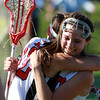 Marblehead: Marblehead's Kiley Fischer, left, and Caroline Helmes, right, hug after the Magicians won a close 13-12 contest over Wayland in the D2 North Semi Final on Tuesday afternoon. David Le/Salem News