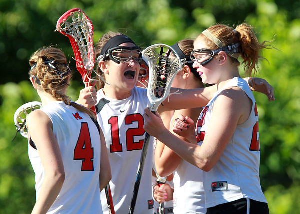 Marblehead: Marblehead senior Meggie Collins congratulates senior teammate Tyler Phillips after she scored the go-ahead goal on a free position shot with 1:14 left in the game. David Le/Salem News