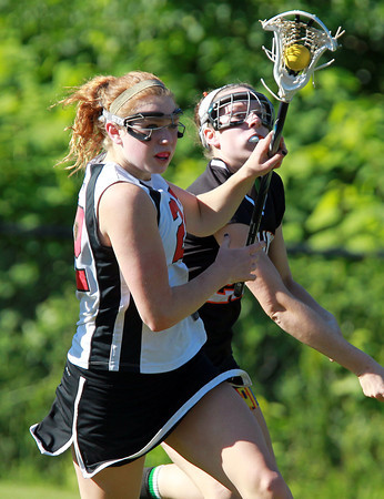Marblehead: Marblehead senior Tyler Phillips cradles the ball as she flies towards the Wayland net on Tuesday afternoon. David Le/Salem News