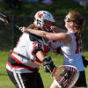 Marblehead: Marblehead senior goalie Allie Forman, left, is greeted with a big hug from sophomore Casey Collins, right, after the Magicians defeated Wayland 13-12 with a last minute goal from senior Tyler Phillips to advance to the D2 North Final. David Le/Salem News