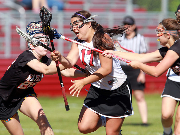 Marblehead: Marblehead senior Cassie Rodgers splits two Wayland while getting fouled on the play. David Le/Salem News