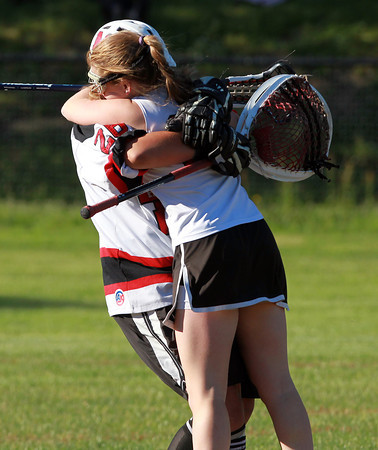 Marblehead: Marblehead senior goalie Allie Forman, left, sweeps up sophomore Casey Collins, into a big hug after the Magicians defeated Wayland 13-12 with a last minute goal from senior Tyler Phillips to advance to the D2 North Final. David Le/Salem News