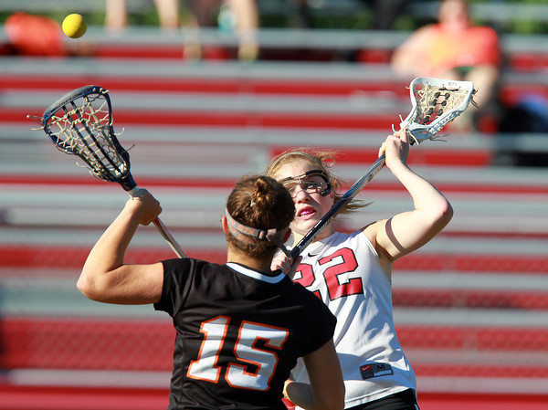 Marblehead: Marblehead senior midfielder Tyler Phillips takes a face-off with Wayland's Madeline Schwartz, left, during the second half of play on Tuesday afternoon. David Le/Salem News