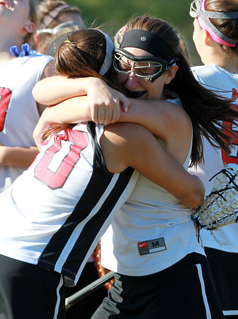 Marblehead: Marblehead seniors Meggie Collins, right, and Kiley Fischer hug after a dramatic 13-12 win over Wayland in the D2 North Semi Final on Tuesday afternoon. David Le/Salem News