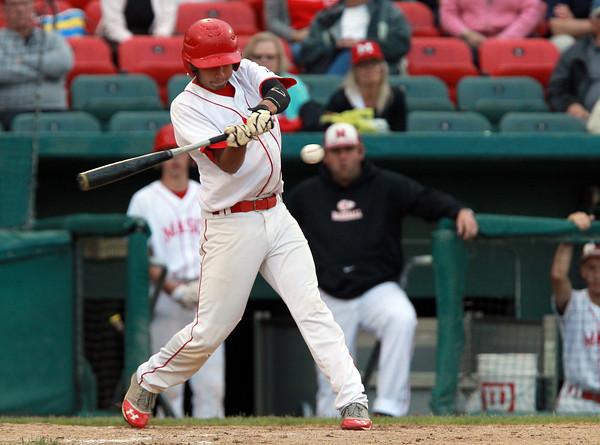 Brockton: Masco senior Greg Jain (9) lines a base hit to centerfield. David Le/Salem News