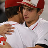 Brockton: Masco senior Speros Varinos (5), right, gets a hug from his brother, freshman Elias Varinos (2), after the Chieftans fell to Hingham in the Division II State Semifinal at Campanelli Stadium in Brockton on Wednesday evening. David Le/Salem News