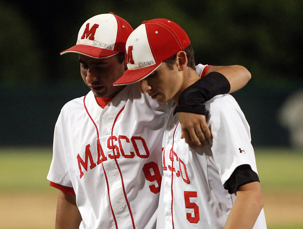 Brockton: Masco senior Greg Jain (9), left, walks off the diamond at Campanelli Stadium with his arm around senior teammate Speros Varinos (5), after the Chieftans fell 2-1 in the Division II State Semifinal on Wednesday evening. David Le/Salem News
