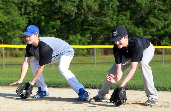 Peabody: Returning **Peabody National** All-Stars, Mason Zeuli, left, and Tyler MacGregor, will alternate on the hill and at shortstop this summer in the District 16 Tournament. David Le/Salem News