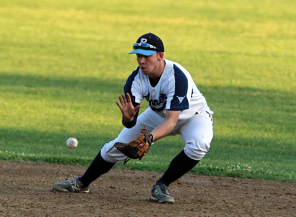 Peabody: Peabody second baseman Matt McIsaac cleanly fields a ground ball and fires onto first to retire a Lowell batter on Saturday evening. David Le/Salem News