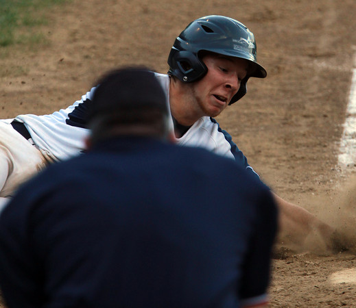 Peabody: Peabody's Matt McIsaac slides safely into home on a close play at the plate to score the Tanners' first run of the game on a sacrifice fly. David Le/Salem News
