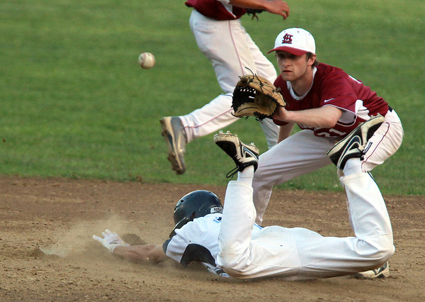 Peabody: Peabody's CJ Allimonte slides safely into second base as Lowell second baseman Tyler Schermerhorn waits for the throw. Allimonte stole second and third base and then scored on a passed ball to give the Tanners a 3-1 lead in the bottom of the 5th inning. David Le/Salem News