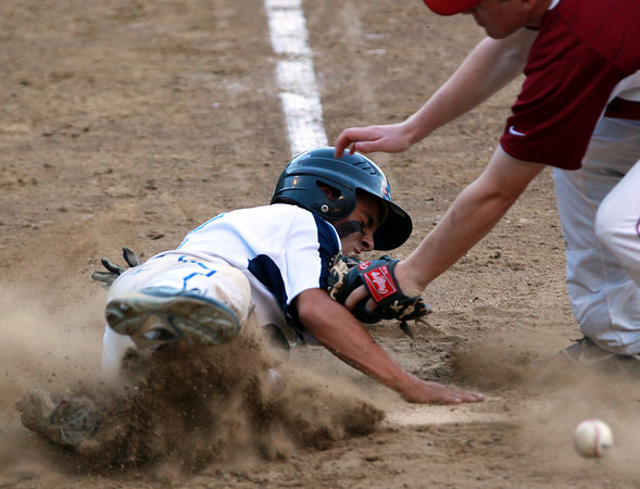 Peabody: Peabody's CJ Allimonte slides safely into home plate as the ball bounces away from Lowell starting pitcher Cam Latta as Allimonte scored on a passed ball to put the Tanners up 3-1. David Le/Salem News