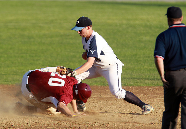 Peabody: Peabody second baseman Matt McIsaac applies the tag to Lowell's Conor Callery on a close play at second base. David Le/Salem News