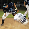 Lynn: St. John's Prep sophomore outfielder Keith Leavitt (22), right, slides safely into second base as the throw from Peabody catcher Brandon Polignone handcuffs Tanners second baseman Matthew McIsaac (4), left. David Le/Salem News