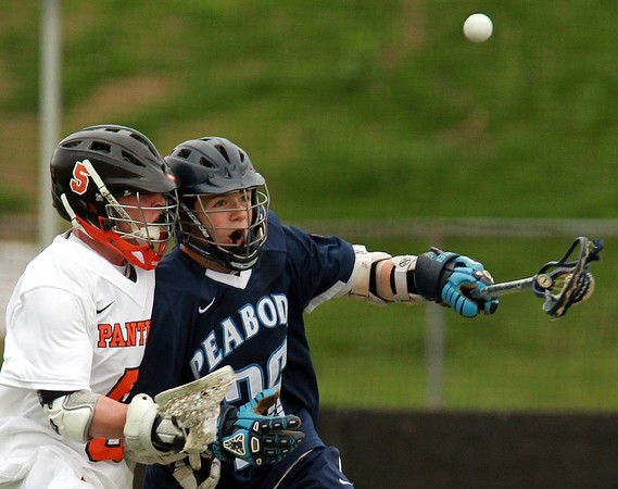 Beverly: Peabody's Keifer Heckman, right, loses control of the ball after being hit by Beverly's Dom Abate, during the second quarter of play. Abate and the Panthers cruised to a 16-4 win on Thursday afternoon. David Le/Salem News