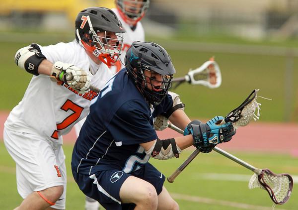 Beverly: Peabody attack Keifer Heckman, right, and the Tanners couldn't get past Beverly's Andrew Irving and the Panthers, falling 16-4 in NEC action on Thursday afternoon. David Le/Salem News