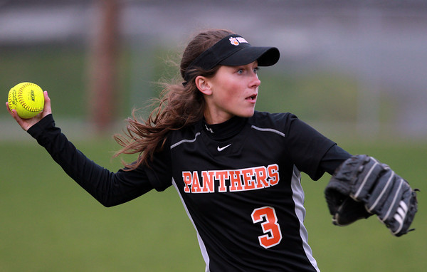 Beverly: Beverly left fielder Molly Pitman looks to make a throw after recording an out. David Le/Staff Photo