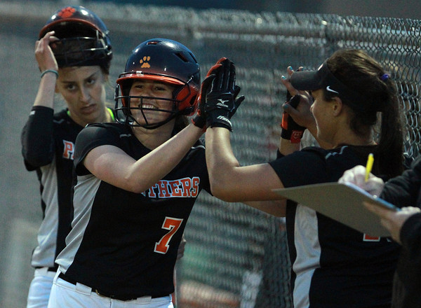 Beverly: Beverly starting pitcher Emily Pitman, left, gets a high five from teammate Natalie Shea, right, after she scored the Panthers second run of the night. David Le/Staff Photo