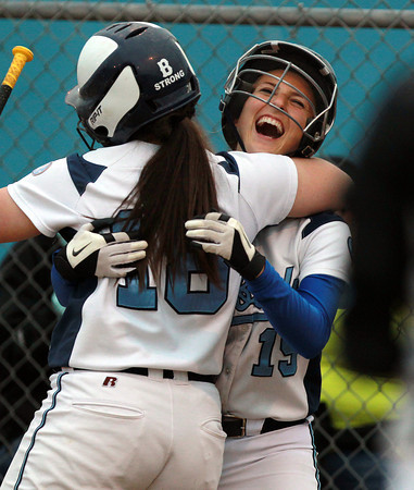 Beverly: Peabody center fielder Jess Raymond, right, celebrates her inside the park home run with teammate Olivia Brothers, left, on Wednesday evening against Beverly. David Le/Staff Photo