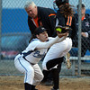 Beverly: Peabody second baseman Alex Romano records an out on a close play at first base as Beverly's Kate Silvestri touches the base a second too late. David Le/Staff Photo