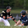 Peabody: Bishop Fenwick second baseman Nick Fanjoy applies the tag to Peabody's Matt McIsaac as he slides into second base on a steal attempt. David Le/Salem News