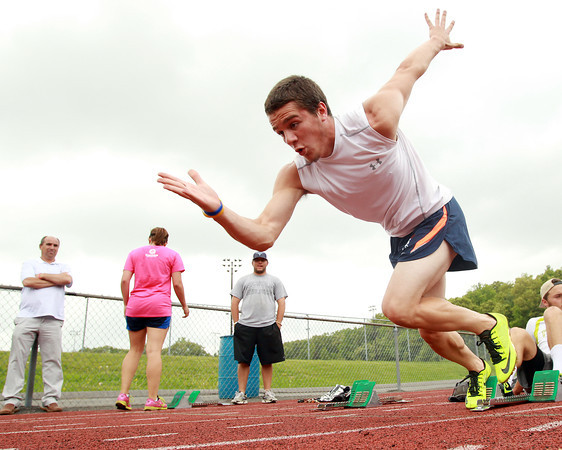 Peabody: Peabody senior Chris Cennami practices his block starts at practice on Thursday afternoon. Cennami who has the Tanner school record in the 100 meters, will look to win the All-State D1 Title this Saturday at Andover High School. David Le/Salem News