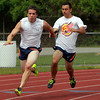 Peabody: Peabody senior Chris Cennami practices handoffs with senior teammate Steve Villani, right, on Thursday afternoon. Cennami has the Tanner school record in the 100 meters, will look to win the All-State D1 Title this Saturday at Andover High School in addition to participating in the 200 meters and 4x100 relay. David Le/Salem News